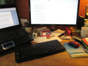 Despite what they say about a cluttered desk,  when mine looks like this it means I'm focused  on a project to the exclusion of everything else.  Right now it's getting Rosamond Eternal out the door.
